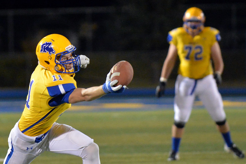 Joel Moline | The Sheridan Press<br /> Sheridan's Izak Aksamit (11) almost catches the ball with one hand against East Friday, Oct. 24, 2019.