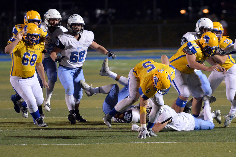 Joel Moline | The Sheridan Press<br /> Sheridan Garrett Coon (5) recovers his balance, refusing to go down against East Friday, Oct. 24, 2019.