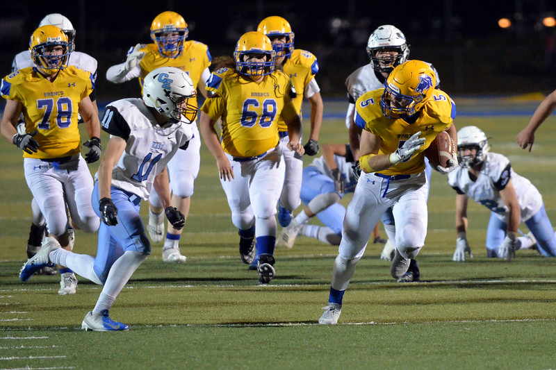 Joel Moline | The Sheridan Press<br /> Sheridan Garrett Coon (5) runs down the middle of the field against East Friday, Oct. 24, 2019.
