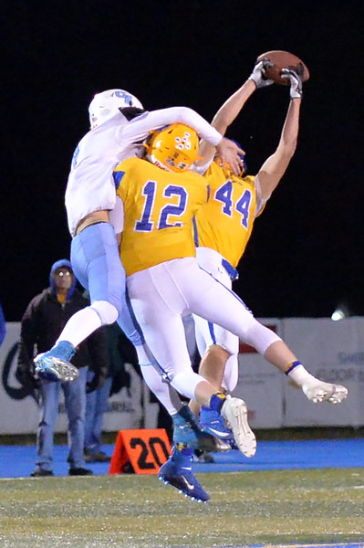 Joel Moline | The Sheridan Press<br /> Sheridan Kyle Meinecke (44) intercepts a pass on a jump ball opportunity against East Friday, Oct. 24, 2019.