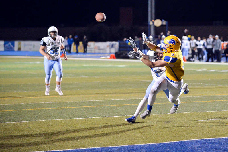 Joel Moline | The Sheridan Press<br>Sheridan's Garrett Coon (5) opens wide to catch a pass with Cheyenne East defense close by Friday, Oct. 25, 2019. Coon caught the pass for a touchdown.
