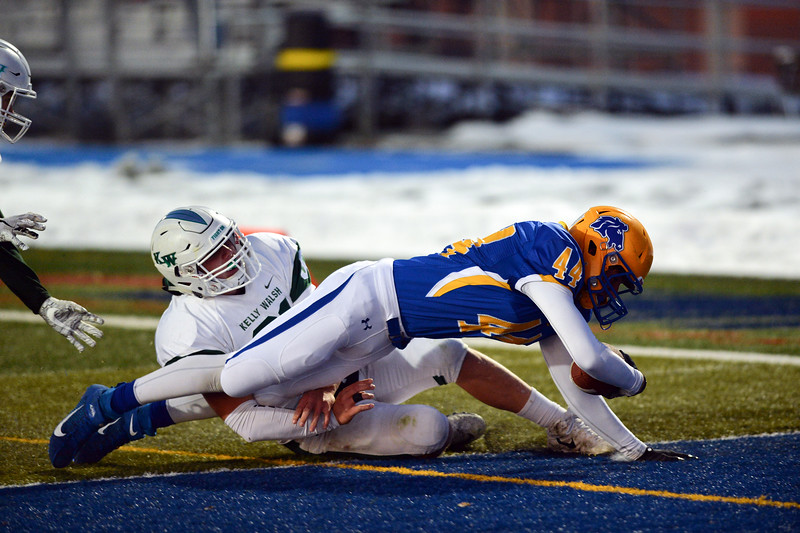 Joel Moline | The Sheridan Press<br /> Sheridan's Kyle Meinecke (44) is tackled into the endzone against Kelly Walsh High School Friday, Nov. 1, 2019.