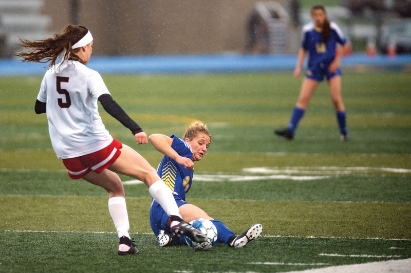 Matthew Gaston | The Sheridan Press<br>Sheridan's Braylee Standish (22) slide tackles her opponent Friday, April 26, 2019.