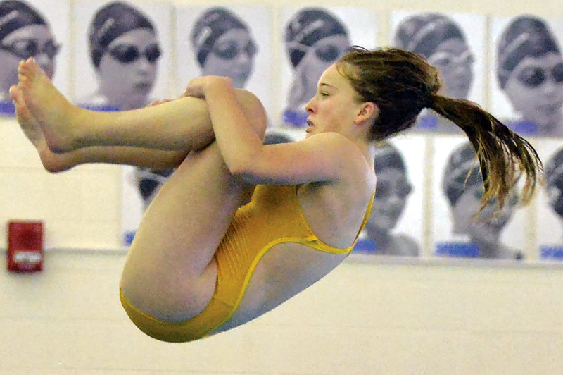 Joel Moline | The Sheridan Press<br /> Sheridan's Maggie Moseley flips in the air while performing a dive during duals against Gillette and Newcastle on Friday, Oct. 4, 2019.