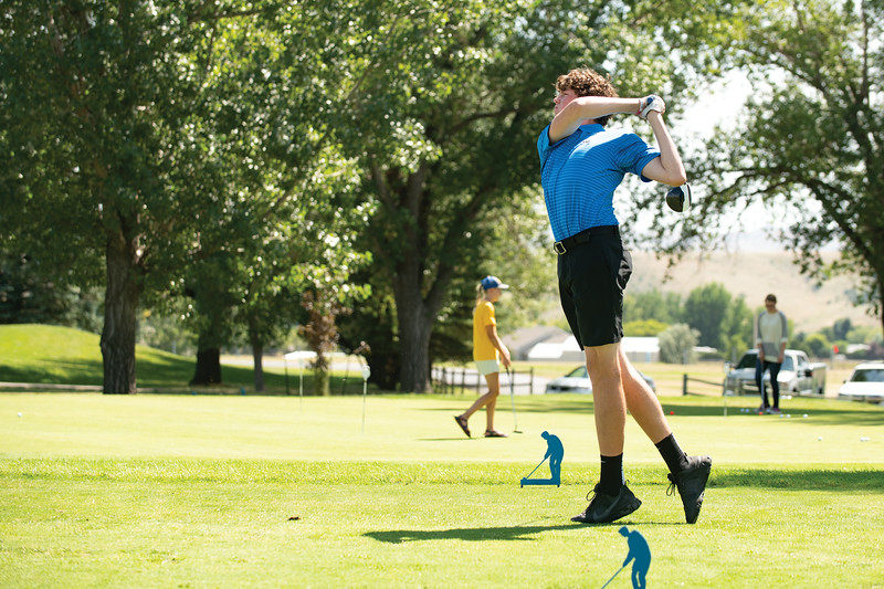 Matthew Gaston | The Sheridan Press<br>Sheridan's Sam Lecholat drives off the first tee during the Sheridan High School golf teams season opener Thursday, Aug. 22, 2019.