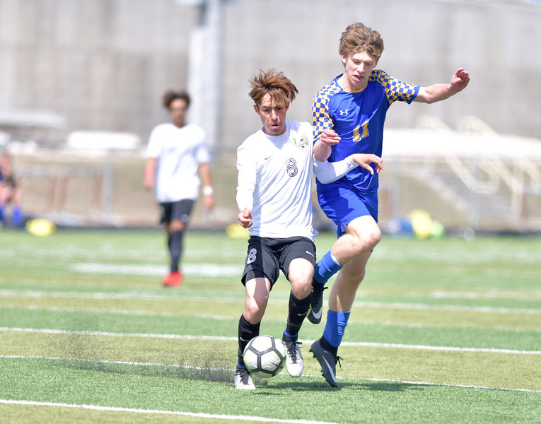 Ryan Patterson | The Sheridan Press<br /> Sheridan's Ethan Rickett, right, battles for the ball with Cheyenne South's Kevin Chavez during the game at Big Horn High School Saturday, April 13, 2019. Rickett tallied an assist in Sheridan's 2-1 victory.