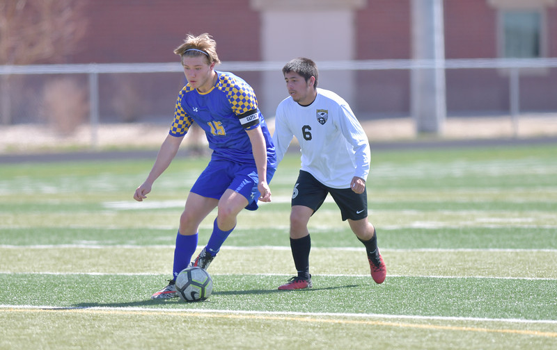 Ryan Patterson | The Sheridan Press<br /> Sheridan's Tristan Bower dribbles the ball against Cheyenne South's Oscar Sanchez during the game at Big Horn High School Saturday, April 13, 2019. Bower scored a goal in Sheridan's 2-1 win.
