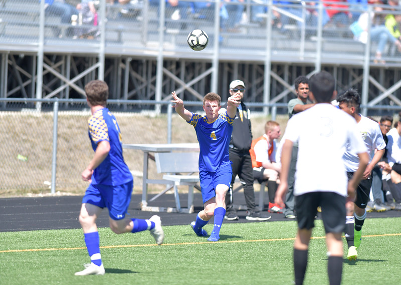 Ryan Patterson | The Sheridan Press<br /> Sheridan's Tobin Reynolds throws the ball in during the game at Big Horn High School Saturday, April 13, 2019. Sheridan scored two goals in the second half and won 2-1.