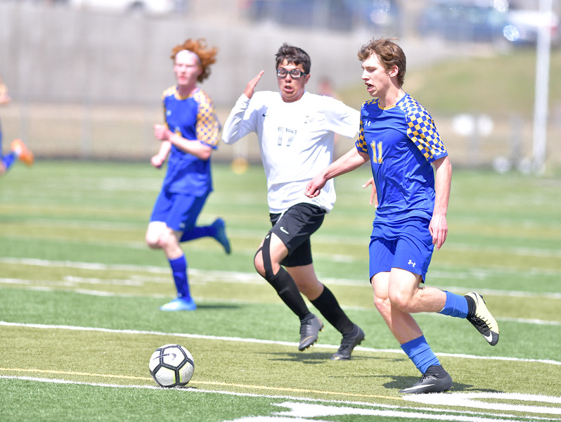 Ryan Patterson | The Sheridan Press<br /> Sheridan's Ethan Rickett, right, dribbles the ball against Cheyenne South's Rodrigo Velazquez during the game at Big Horn High School Saturday, April 13, 2019. The Broncs defeated the Bison 2-1.