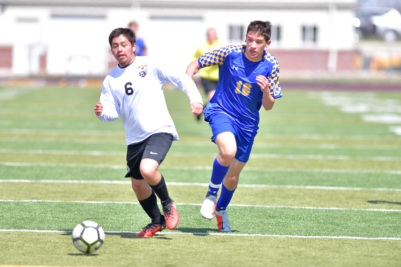 Ryan Patterson | The Sheridan Press<br /> Sheridan's Landon Negron, right, goes for the ball against Cheyenne South's Oscar Sanchez during the game at Big Horn High School Saturday, April 13, 2019. The Broncs won 2-1 and improved to 3-5 in conference.