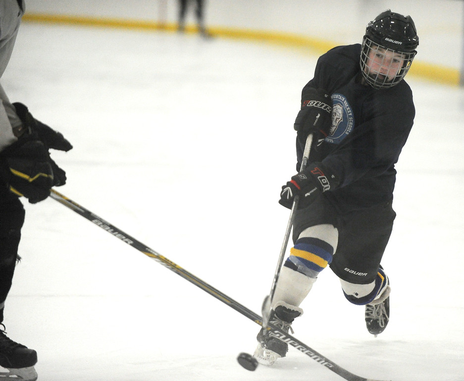 Camdyn Cook fires a shot during the Sheridan Hawks practice at Whitney Rink at the M&M's Center on Monday night.