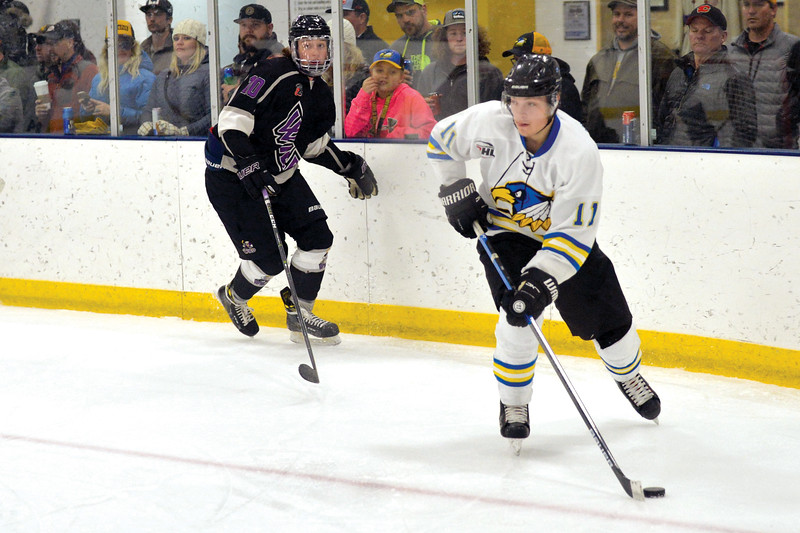 Joel Moline | The Sheridan Press<br /> Sheridan Hawks NA3HL team's Justin Schwartzmiller (11) looks for an open teammate against the Gillette Wild Saturday, Oct. 26, 2019.