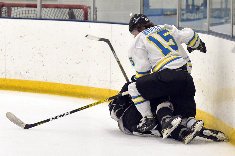 Joel Moline | The Sheridan Press<br /> Sheridan Hawks NA3HL team's Kolton Wright (15) know down an opposing skater against the Gillette Wild Saturday, Oct. 26, 2019.