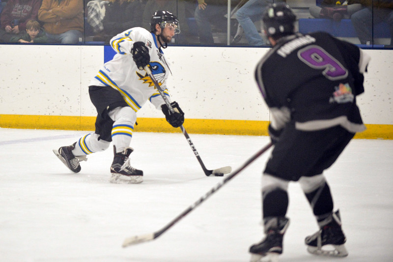 Joel Moline | The Sheridan Press<br /> Sheridan Hawks NA3HL team's Sandis Cook (3) takes a shot at the goal against the Gillette Wild Saturday, Oct. 26, 2019.