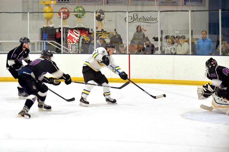 Joel Moline | The Sheridan Press<br /> Sheridan Hawks NA3HL team's Justin Schwartzmiller (11) takes a shot on goal against the Gillette Wild Saturday, Oct. 26, 2019.