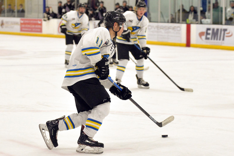 Joel Moline | The Sheridan Press<br /> Sheridan Hawks NA3HL team's Justin Schwartzmiller (11) looks for an opening in the defense against the Gillette Wild Saturday, Oct. 26, 2019.