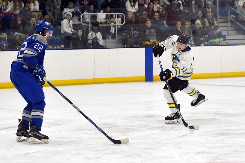 Joel Moline | The Sheridan Press<br /> Sheridan NA3HL Hawks player Justin Schwartzmiller (11) takes a shot on goal against the Helena Bighorns Friday, Nov. 2, 2019.