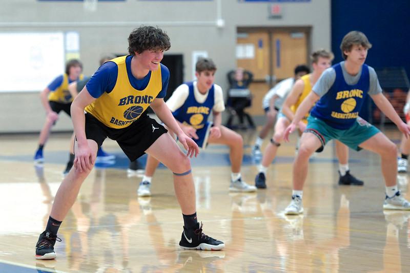 Joel Moline | The Sheridan Press<br /> Sam Lecholat smiles as the Sheridan High School boys basketball team goes through a drill during practice Monday, Nov. 25, 2019.