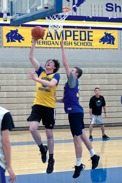 Joel Moline | The Sheridan Press<br /> Sam Lecholat scores a layup with the defense on his back during practice Monday, Nov. 25, 2019.