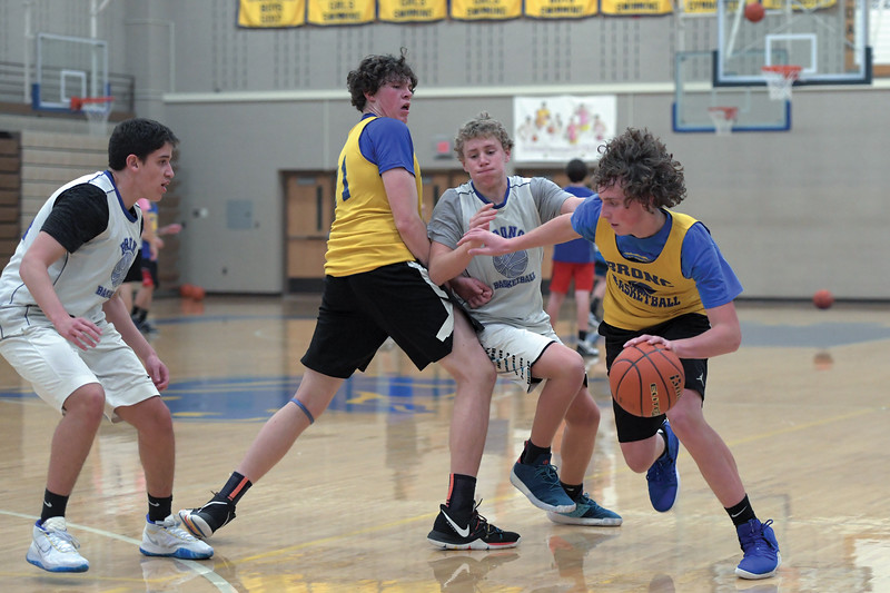 Joel Moline | The Sheridan Press<br /> Kevin Woodrow, far right, uses a screen set by Same Lecholat to move past the defense during practice Monday, Nov. 25, 2019.