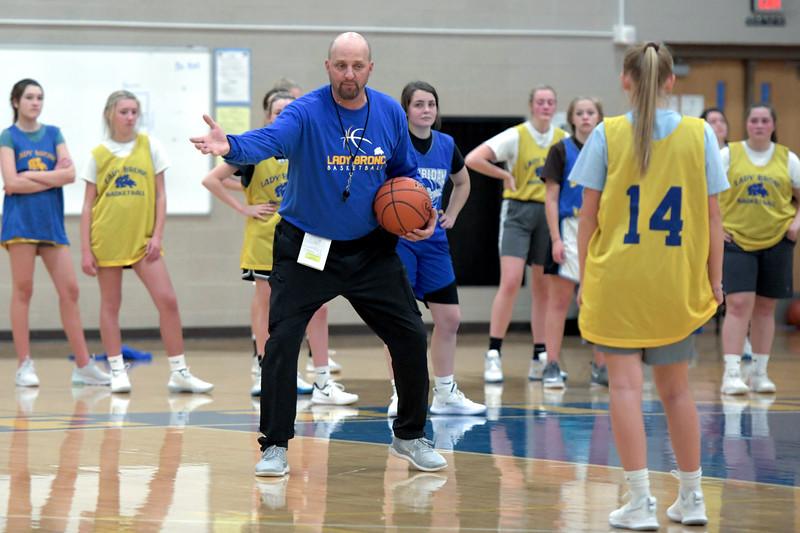 Joel Moline | The Sheridan Press<br /> Head coach Larry Ligocki explains a drill to the Sheridan High School girls basketball team during practice Monday, Nov. 25, 2019.