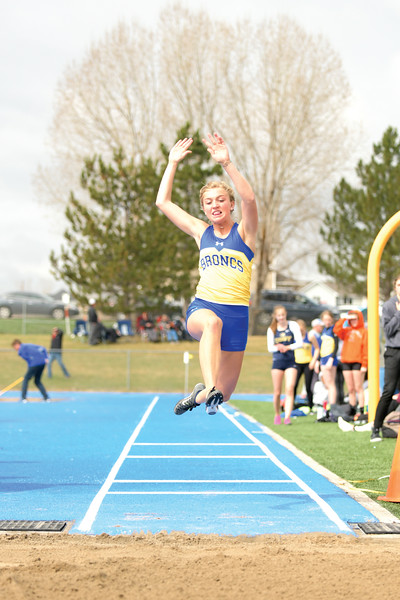 Matthew Gaston | The Sheridan Press<br>Sheridan's Lizzie Arnold makes her second attempt at the long jump Tuesday, April 16, 2019.