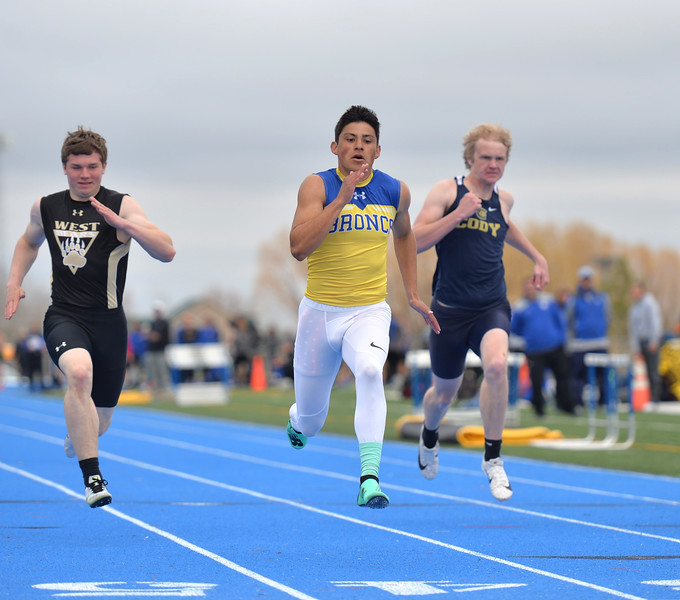 Bud Denega | The Sheridan Press<br /> Sheridan's Matt Roma competes in the 100-meter dash during the Gary Benson Invite at Homer Scott Field Tuesday, April 16, 2019.