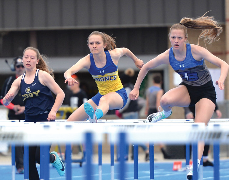 Bud Denega | The Sheridan Press<br /> Sheridan's Rachel Petersburg competes in the 100-meter hurdles during the Gary Benson Invite at Homer Scott Field Tuesday, April 16, 2019.