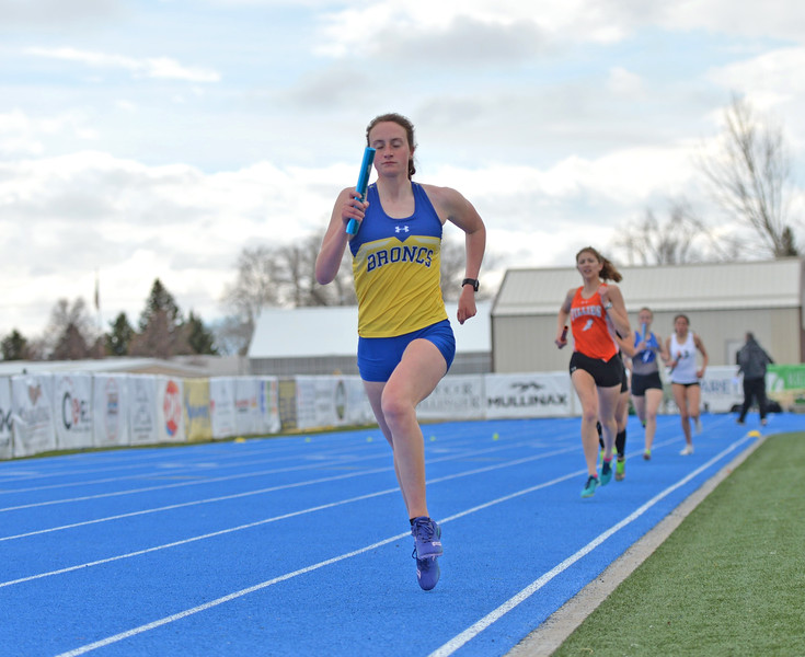 Bud Denega | The Sheridan Press<br /> Sheridan's Zoe Robison competes in the 3,200-meter relay during the Gary Benson Invite at Homer Scott Field Tuesday, April 16, 2019.