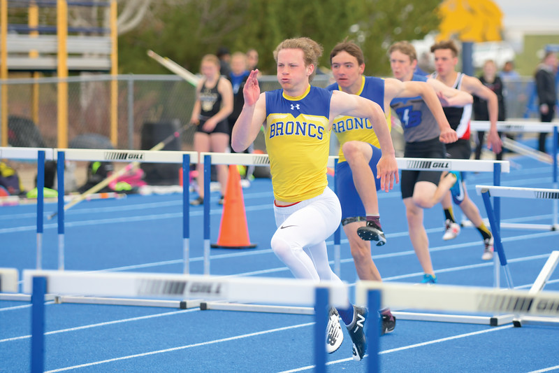 Matthew Gaston | The Sheridan Press<br>Sheridan's Alec Riegert takes an early lead in the 110m hurdles during the Benson Invitational Tuesday, April 16, 2019.