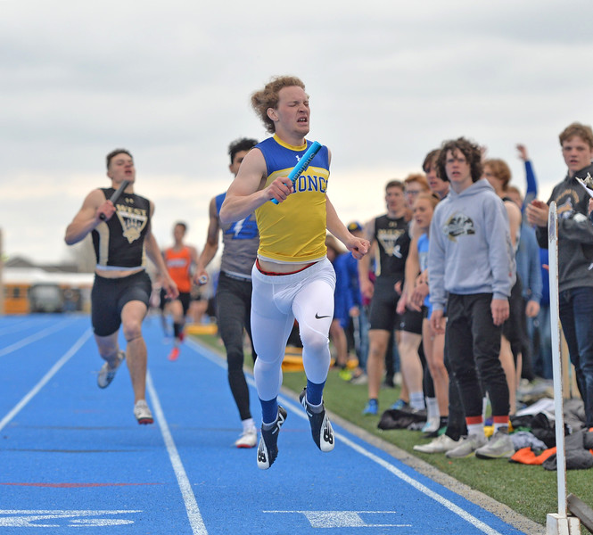 Bud Denega | The Sheridan Press<br /> Sheridan's Alec Riegert crosses the finish line during the Gary Benson Invite at Homer Scott Field Tuesday, April 16, 2019.