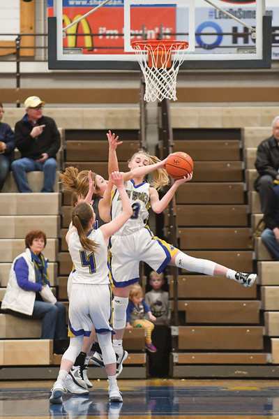 Matthew Gaston | The Sheridan Press<br>Sheridan's Katie Ligocki (33) recovers a shot she blocked during play against Thunder Basin Saturday, Feb. 16, 2019. The Lady Brncs lost 69-26.