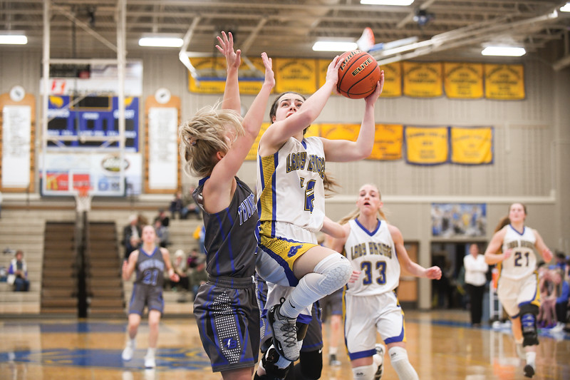 Matthew Gaston | The Sheridan Press<br>Sheridan's Mollie Morris (12) elevates for a layup against Thunder Basin's Abbey Geer (0) at Sheridan High School Saturday, Feb. 16, 2019.