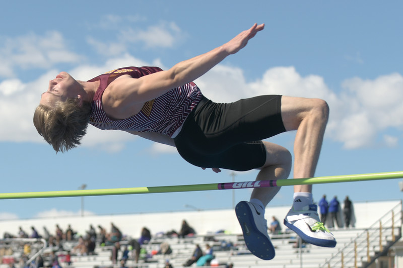 Matthew Gaston | The Sheridan Press<br>Big Horn's high flying Kade VanDyken soars over the bar during the high jump Saturday, April 13, 2019.