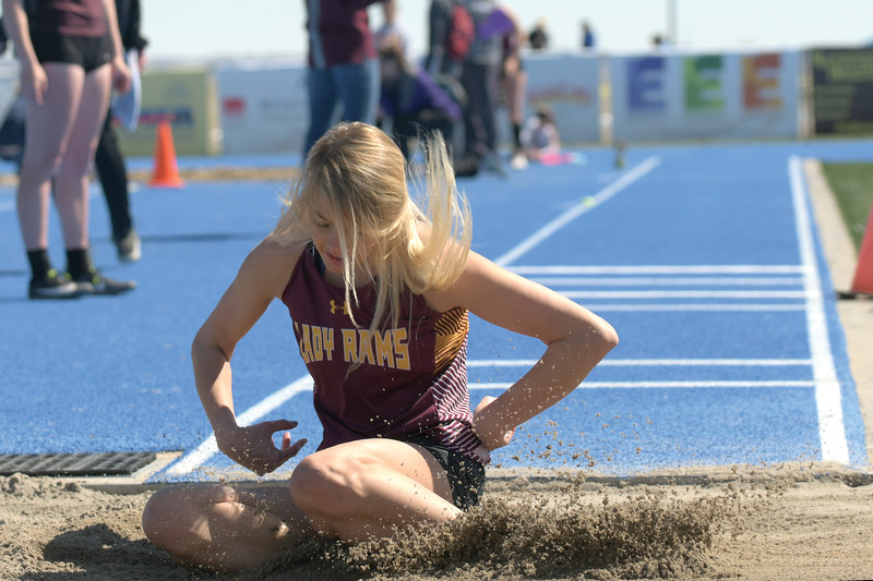 Matthew Gaston | The Sheridan Press<br>Big Horn's Alisyn Hutton lands in the pit after her first triple jump attempt at Homer Scott Field Saturday, April 13, 2019.
