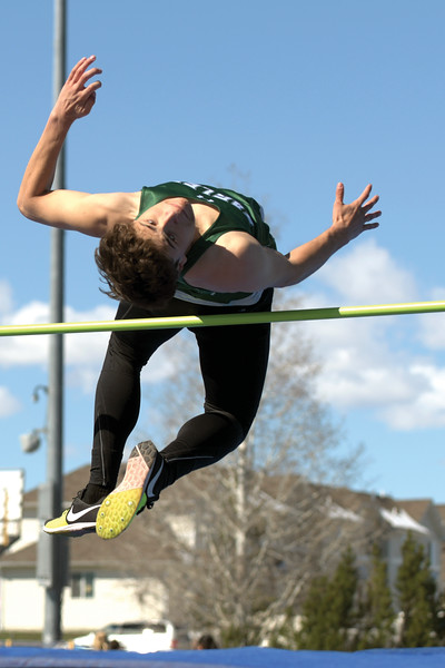 Matthew Gaston | The Sheridan Press<br>Tongue River's Cooper Vollmer arches over the bar during the high jump at Homer Scott Field Saturday, April 13, 2019.