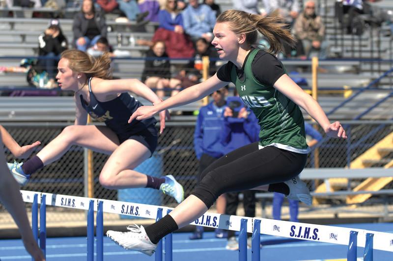 Matthew Gaston   The Sheridan Press<br>Tongue River's Jane Pendergast runs the 100m hurdles at Homer Scott Field Saturday, April 13, 2019.