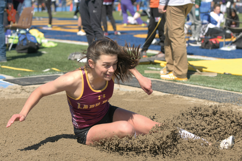 Matthew Gaston | The Sheridan Press<br>Big Horn's Torie Greenelsh smiles as lands her third long jump of the day Saturday, April, 13, 2019.
