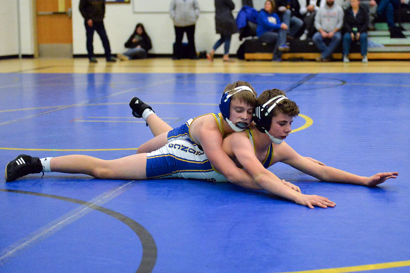 Joel Moline | The Sheridan Press<br /> Sheridan's Cole Hansen takes the top position over teammate Drake Figusduring the Blue/Gold Dual Tuesday, Dec. 10, 2019.