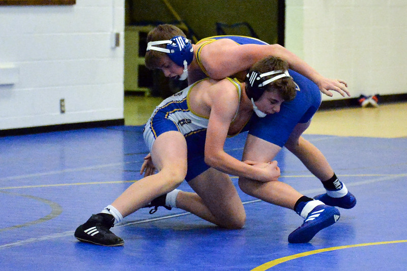 Joel Moline | The Sheridan Press<br /> Sheridan's Drake Figus, lower, attempts to take down teammate Cole Hansen during the Blue/Gold Dual Tuesday, Dec. 10, 2019.
