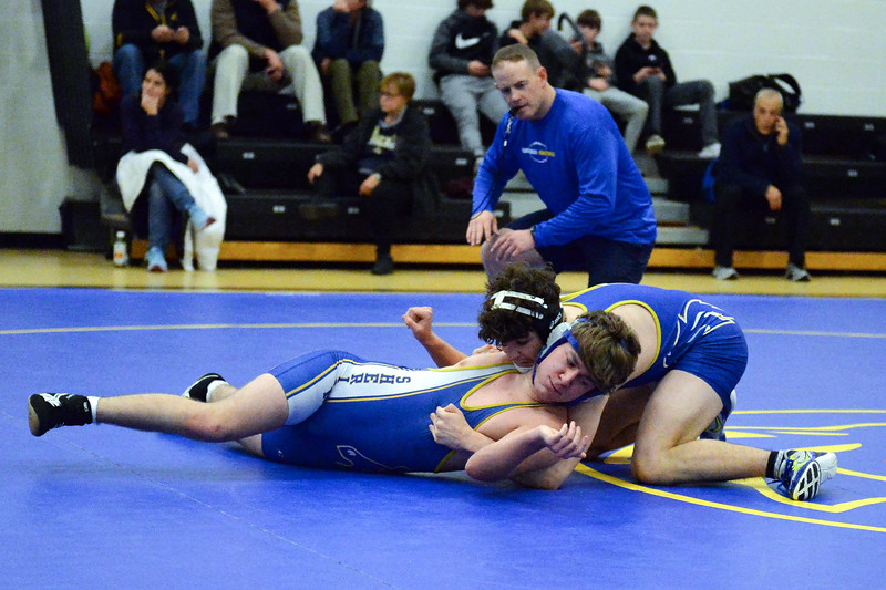 Joel Moline | The Sheridan Press<br /> Sheridan's Damien Detavenier, front, fights from being pinned by teammate Colson Coon during the Blue/Gold Dual Tuesday, Dec. 10, 2019.
