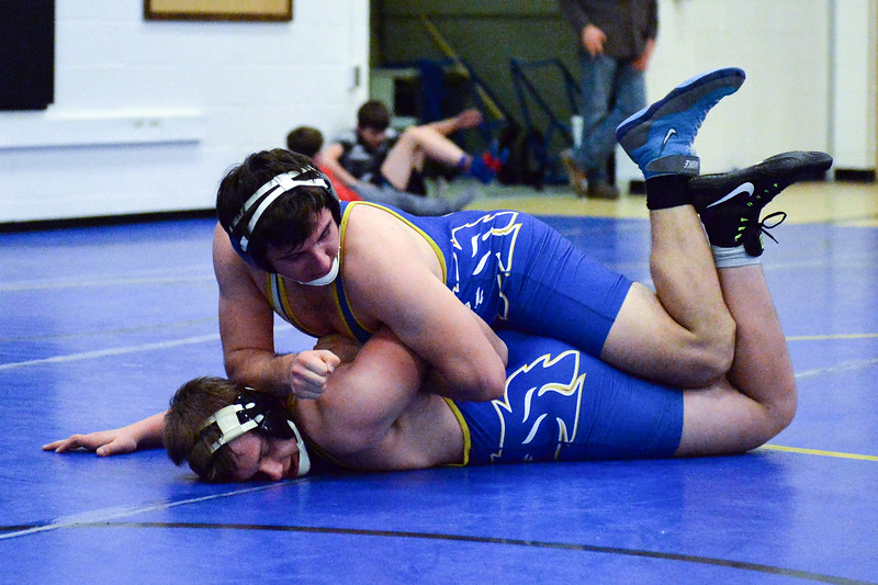 Joel Moline | The Sheridan Press<br /> Sheridan's Camden McArthur rides teammate Jim Strobbe during the Blue/Gold Dual Tuesday, Dec. 10, 2019.