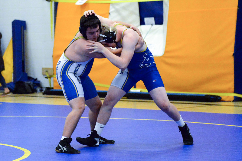 Joel Moline | The Sheridan Press<br /> Sheridan's Dylan Reeves, right, and Chris Larson attempt to gain control over each other during the Blue/Gold Dual Tuesday, Dec. 10, 2019.