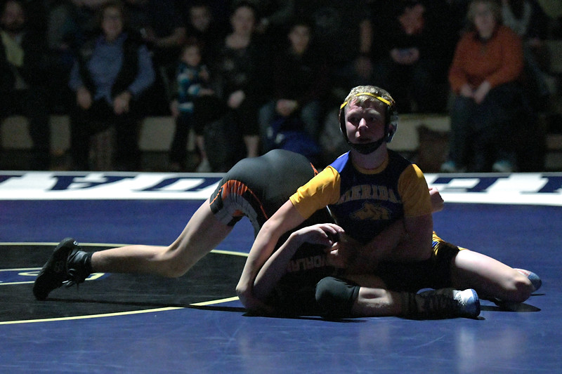 Joel Moline | The Sheridan Press<br /> Sheridan's Kolton Powers has his opponent stuck but time experience in the first period of the 106-pound match in the dual against Worland, Thursday, Dec. 12, 2019.  Powers would win by pin in the second period.
