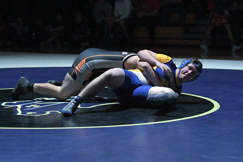 Joel Moline | The Sheridan Press<br /> Sheridan's Ethan Johnson fights to escape from the bottom postion in the dual against Worland, Thursday, Dec. 12, 2019.