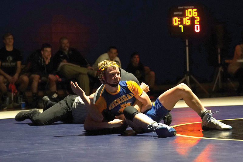 Matthew Gaston | The Sheridan Press<br>Sheridan's Kolton Powers claims a victory during his first official wrestling match of his high school career Thursday, Dec. 12, 2019.