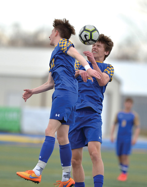 Bud Denega | The Sheridan Press<br /> Sheridan's Ethan Rickett, right, and Carter Wells rise to head the ball during a game against Campbell County at Homer Scott Field Saturday, April 6, 2019.