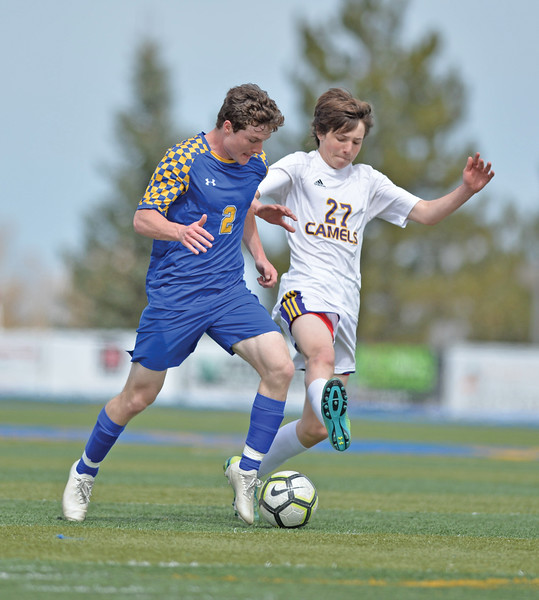 Bud Denega | The Sheridan Press<br /> Sheridan's Toby Jacobs handles the ball during a game against Campbell County at Homer Scott Field Saturday, April 6, 2019.