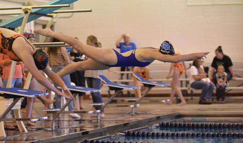 Bud Denega | The Sheridan Press<br /> Zoe Robison dives in during the Sheridan Pre-Invite at Sheridan Junior High Friday, Sept. 21, 2018. The Lady Broncs host the Sheridan Invite Saturday beginning at 9 a.m.