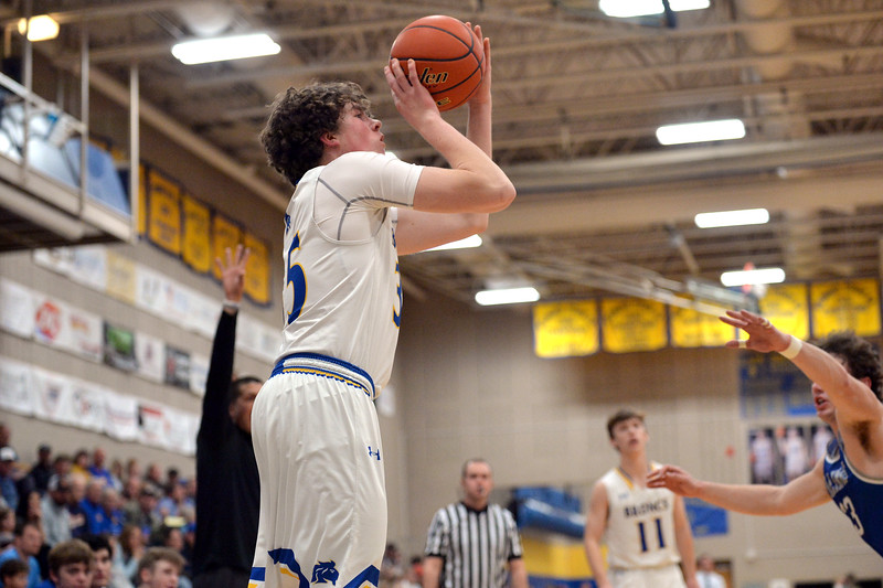 Joel Moline | The Sheridan Press<br /> Sheridan's Sam Lecholat (35) makes a 3-pointer from the corner against Billings Skyview High School Friday, Jan. 17, 2020.